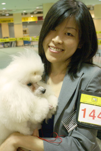 Ms Annie Goh Winning At MKA Show With Her Poodle